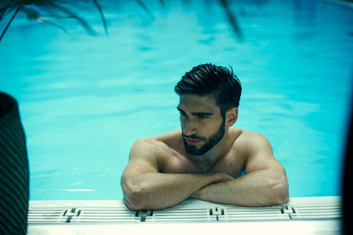 Man chilling by pool. Editorial fashion series for Bogstadveien Magazine in Oslo by Håvard Schei.