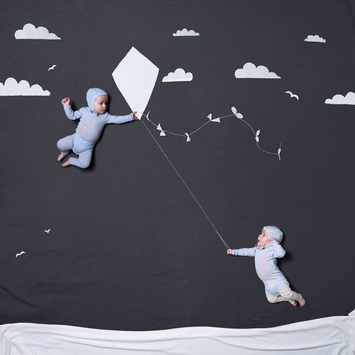 Twin boys playing with a kite. Advertising for Norwegian wool brand Lilli Leopold by håvard schei